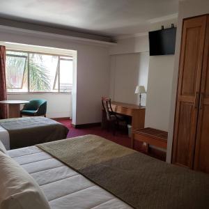 Cama o camas de una habitación en Hotel Gavina Express