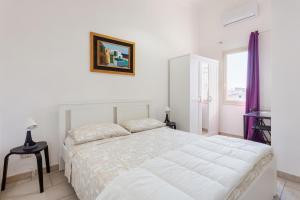 Letto o letti in una camera di Appartamenti Francesco