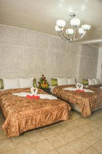 A bed or beds in a room at UW Oasis Hotel