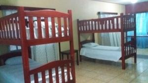 A bunk bed or bunk beds in a room at Hotel Casa Marina