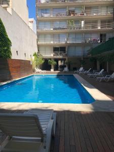 The swimming pool at or near Departamento a estrenar en Palermo con pileta.