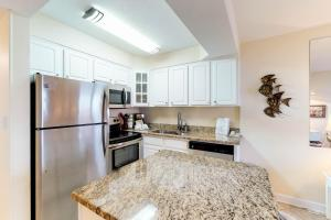 A kitchen or kitchenette at Jetty East Condos