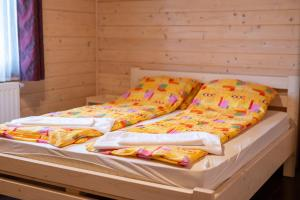A bed or beds in a room at 3A Guest House