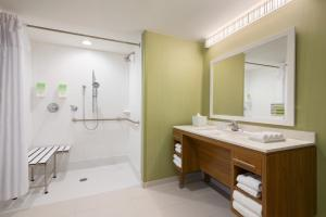 A bathroom at Home2 Suites by Hilton Orlando International Drive South