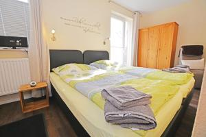 A bed or beds in a room at Hotel-Pension Weimann