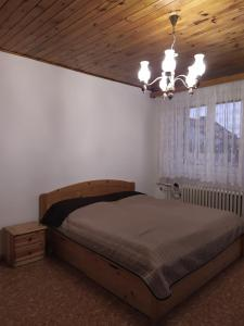 A bed or beds in a room at Cozy house