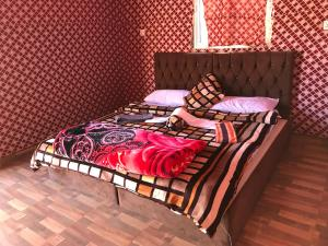 A bed or beds in a room at Jamal Rum Camp