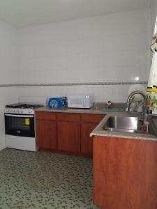 A kitchen or kitchenette at Alondra San Juan Apartments