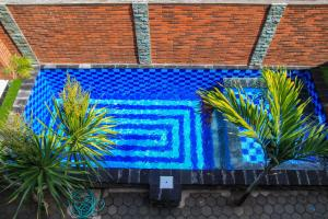 A view of the pool at D'Tegal House or nearby