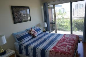 A bed or beds in a room at Villa with Views & Pool