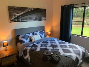 A bed or beds in a room at Port Douglas Family Escape
