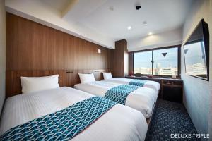 Cama o camas de una habitación en Hotel Amanek Asakusa Ekimae