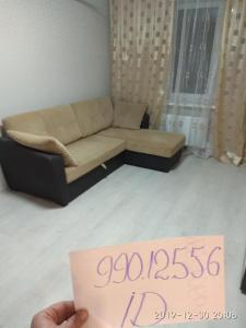 A seating area at уютные апартаменты, ЖК Губернский