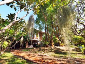 A garden outside BaanSuk Sukhothai Resort