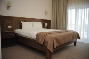 A bed or beds in a room at Porto Riva