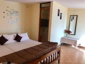 A bed or beds in a room at kollanoor guest house