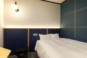 A bed or beds in a room at Urban Hotel