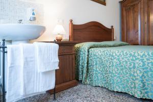 Cama ou camas em um quarto em Corte Canal Venice