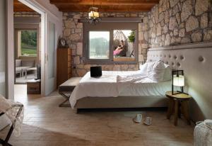 Ένα ή περισσότερα κρεβάτια σε δωμάτιο στο Five Senses Luxury Villas