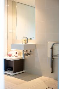 A bathroom at Seahaven Noosa Beachfront Resort