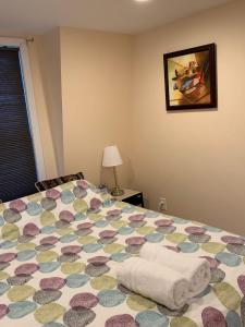 A bed or beds in a room at Beautiful house in Hough Neck