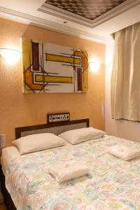 A bed or beds in a room at Hotel Campo Grande