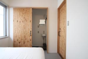 ゲストハウス SHIBAFUにあるベッド