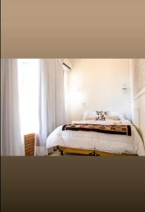A bed or beds in a room at Pousada Saruê Natal