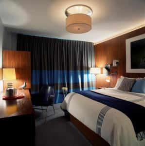A bed or beds in a room at 6 Columbus Central Park Hotel