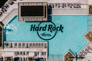 A view of the pool at Hard Rock Hotel Los Cabos or nearby