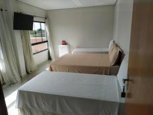 A bed or beds in a room at Hotel Kanaan
