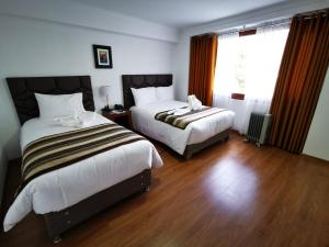 A bed or beds in a room at Hotel Andes de Urubamba