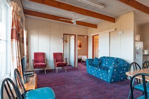 A seating area at Aruma River Resort