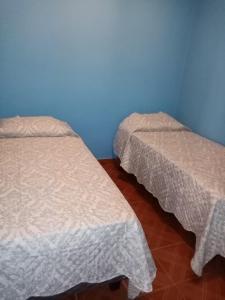Cama o camas de una habitación en Hostal Apanantor