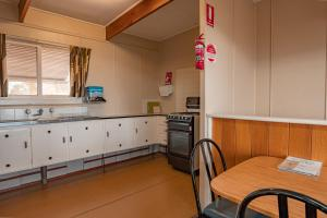 A kitchen or kitchenette at Aruma River Resort