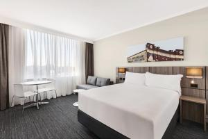 A bed or beds in a room at Travelodge Hotel Bankstown Sydney