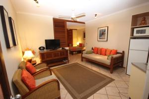 A seating area at Hibiscus Resort And Spa Book Here With The Onsite Reception Open Daily