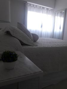 A bed or beds in a room at Complejo Pirovano