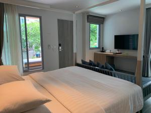 Ein Bett oder Betten in einem Zimmer der Unterkunft Bann Pantai Resort