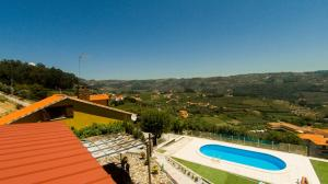 A view of the pool at King's House Douro Valley or nearby