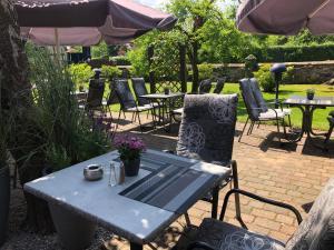 Ein Restaurant oder anderes Speiselokal in der Unterkunft Hotel ARTE Schwerin