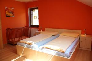 A bed or beds in a room at Villa Park Lipno-Lipno-In