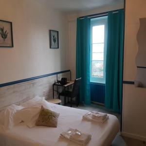 Un ou plusieurs lits dans un hébergement de l'établissement Hôtel Gambetta