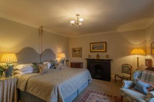 A bed or beds in a room at Glenapp Castle