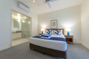 A bed or beds in a room at Mowbray By The Sea