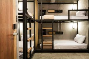 A bunk bed or bunk beds in a room at BED STATION Hostel Ratchthewi