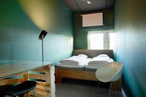 A bed or beds in a room at Urban Camper Hostel