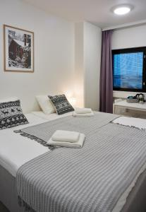 A bed or beds in a room at Inn Tourist Hotel & Hostel