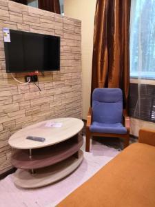 Телевизор и/или развлекательный центр в Отель Усть-Луга