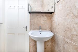 A bathroom at Soho Central Apartments